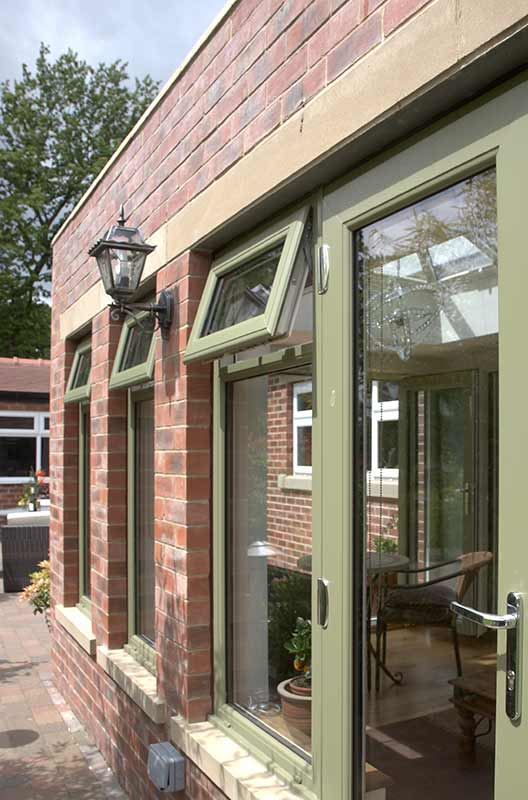 Chartwell green top hung window and a patio door
