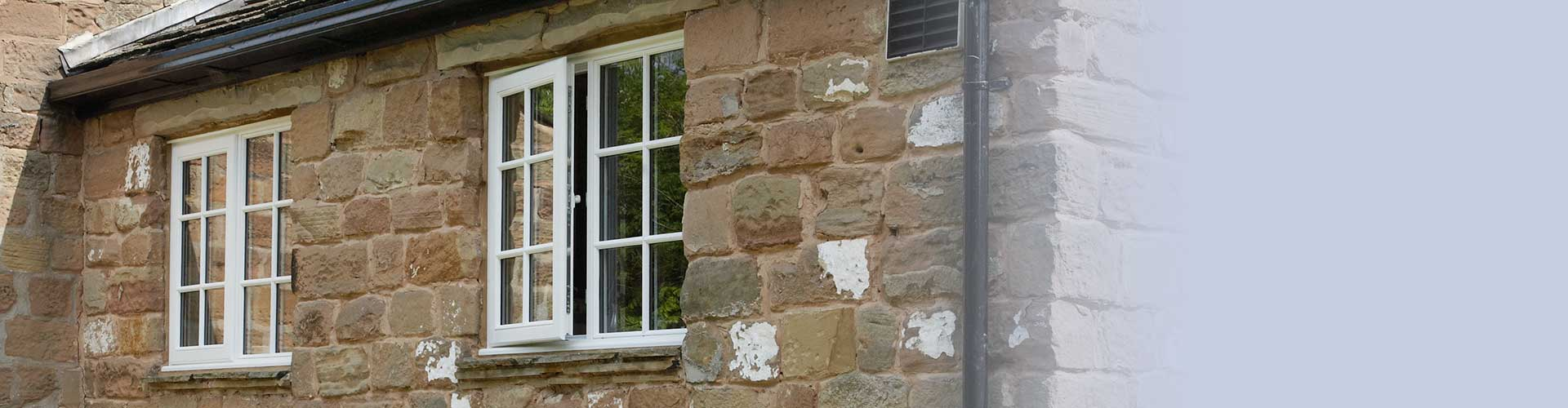 Two upvc casement windows in white